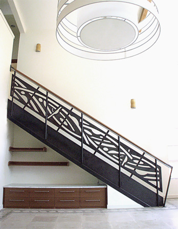 stair rail with stenciled steel panels